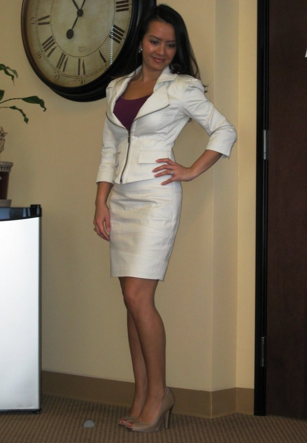 white skirt suit with heels